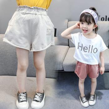 Детски къси панталони в два цвята с джобове и надписи