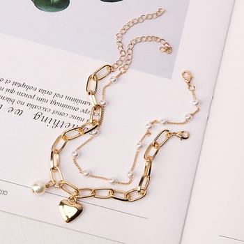 Стилна дамска гривна в златист цвят с перли