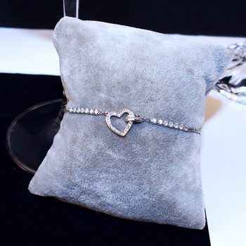 Дамска модерна гривна в сребрист цвят с камъни