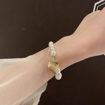 Стилна дамска гривна-в златист цвят с перли
