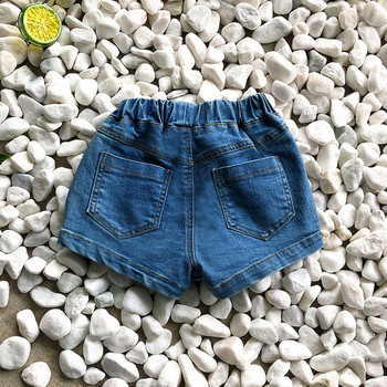Модерна детска пола-панталон с копчета и джобове