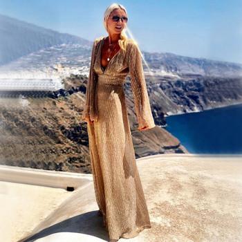Μοντέρνο γυναικείο φόρεμα μακρύ  με βαθύ λαιμόκοψη σε χρυσό χρώμα