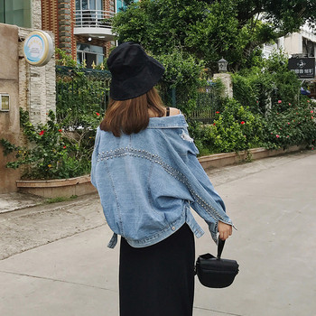 Μοντέρνο γυναικείο μπουφάν με μεταλλικά στοιχεία και μεγέθη μέχρι 5XL