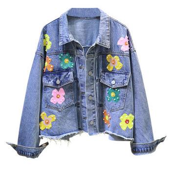 Γυναικείο τζιν μπουφάν με λουλούδια και πέρλες  σε μπλε χρώμα