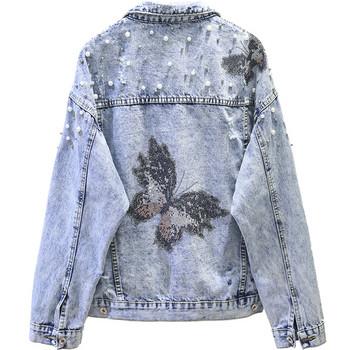 Κομψό γυναικείο τζιν μπουφάν με πέρλες  και εκτύπωση στο πίσω μέρος