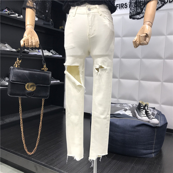 Νέο μοντέλο γυναικεία τζιν  με σκισμένα μοτίβα και υψηλή μέση σε μπλε και άσπρο χρώμα