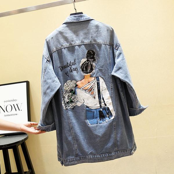 Μοντέρνο γυναικείου denim  μπουφάν με εκτύπωση στη πλάτη σε μπλε χρώμα