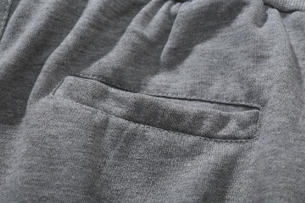 Спортно мъжко долнище с джобове и цип в сив цвят
