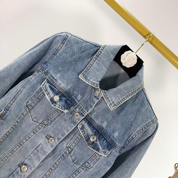 Γυναικείο μπουφάν σε μπλε χρώμα με κουμπιά και τσέπες