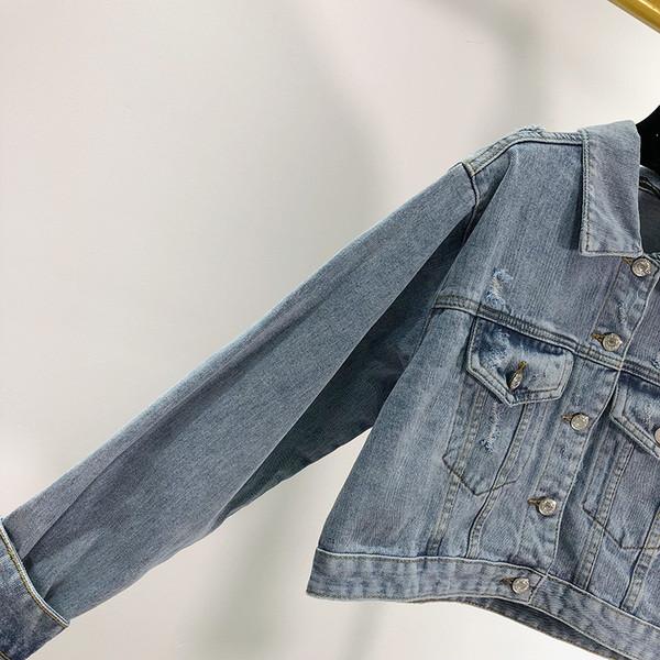Γυναικείο κοντό μπουφάν με μπλε χρώμα και μακριά μανίκια