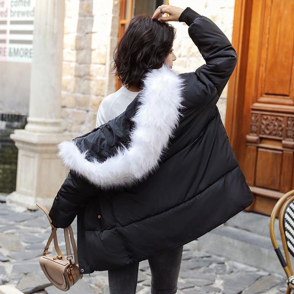 Μοντέρνο γυναικέιο μπουφάν με χνούδι σε μαύρο μπεζ χρώμα