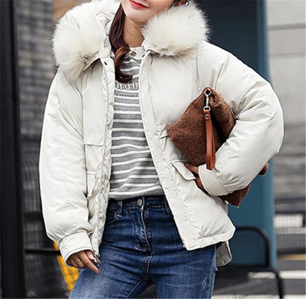Γυναικείο χειμερινό φαρδύ μπουφάν με κουκούλα