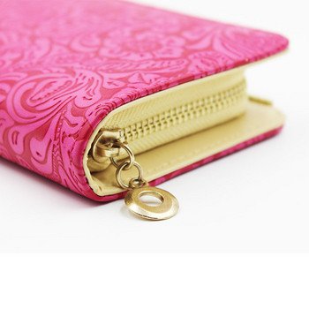 Γυναικείο πορτοφόλι με μεταλλικά στοιχεία και floral print