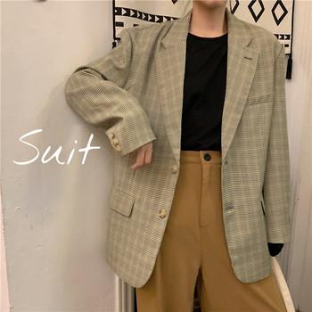 Дамско модерно карирано сако широк модел
