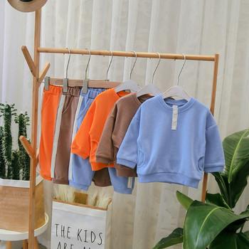Модерен детски комплект за момчета блуза + спортно долнище в син,кафяв и оранжев цвят