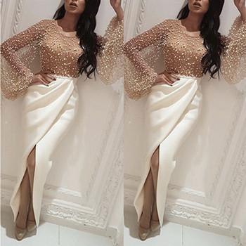 Νέο μοντέλο γυναικείο μακρύ φόρεμα με μακρύ μανίκι και σχισμή σε λευκό χρώμα