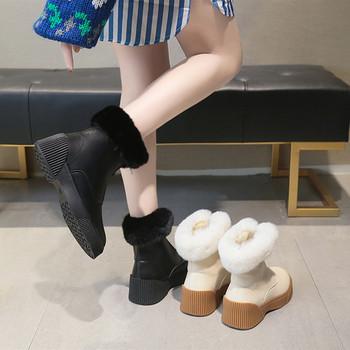 Γυναικείες μπότες με φερμουάρ σε λευκό και μαύρο χρώμα