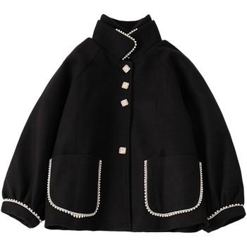 Нов модел дамско палто с копчета и джобове в черен цвят
