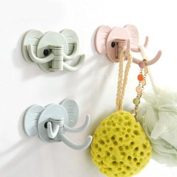 Самозалепваща се пластмасова закачалка с три куки във формата на слон в зелен, розов и син цвят