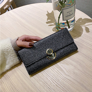 Έκο δερμάτινο γυναικείο πορτοφόλι με κομψό αποτέλεσμα και μεταλλική στερέωση