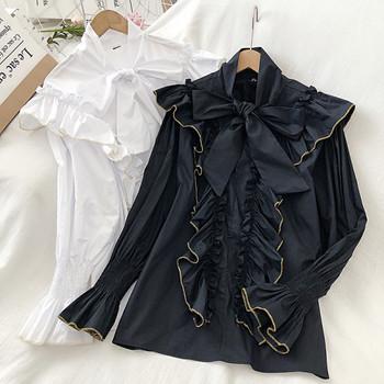 Модерна дамска риза в бял и черен цвят с панделка и лотос ръкав